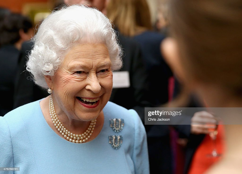 Queen Elizabeth II smiles as she attends a reception for the Queen's Anniversary Prizes for Higher and Further Education at Buckingham Palace on February 27, 2014 in London, England.