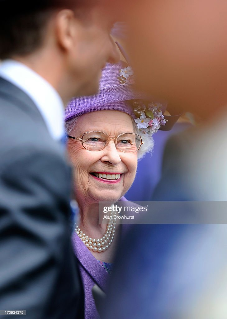 Queen <a gi-track='captionPersonalityLinkClicked' href=/galleries/search?phrase=Elizabeth+II&family=editorial&specificpeople=67226 ng-click='$event.stopPropagation()'>Elizabeth II</a> smiles as she attends Ladies' Day during day three of Royal Ascot at Ascot Racecourse on June 20, 2013 in Ascot, England.