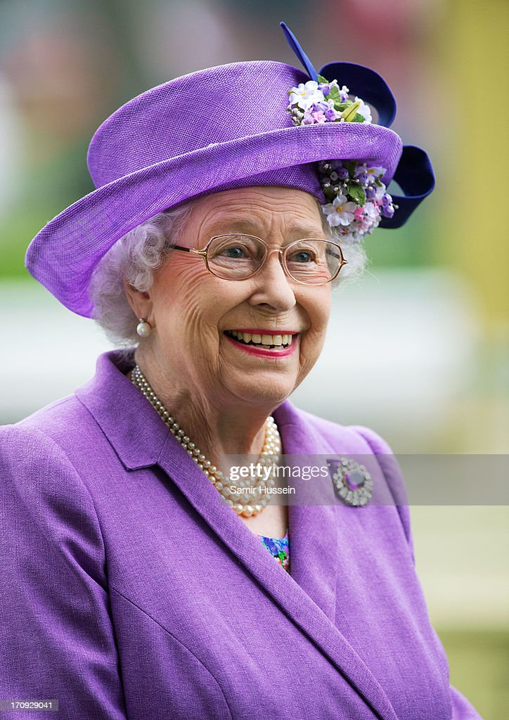 Queen Elizabeth II smiles as she attends Ladies Day on day 3 of Royal Ascot at Ascot Racecourse on June 20, 2013 in Ascot, England.