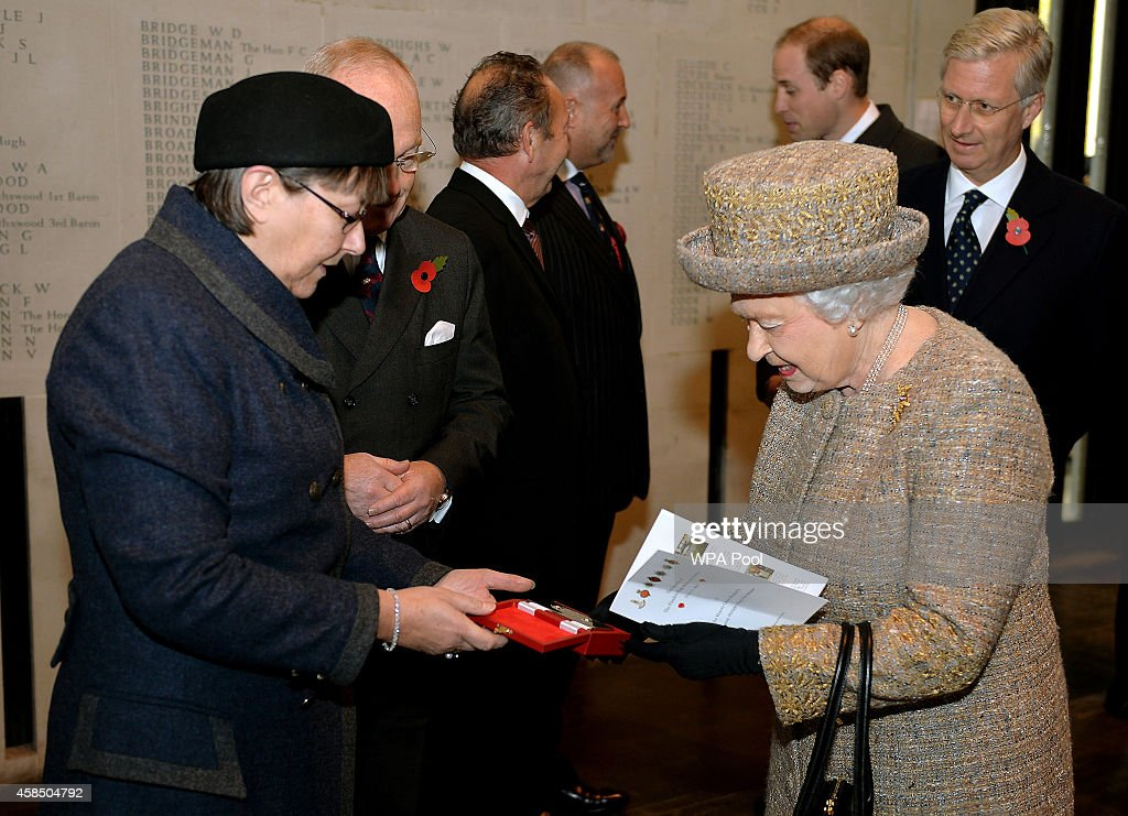 Queen Elizabeth II smiles as she is given a silver box containing soil from WW1 battlefields after the opening of the Flanders' Fields Memorial Garden on November 6, 2014 in London, England.