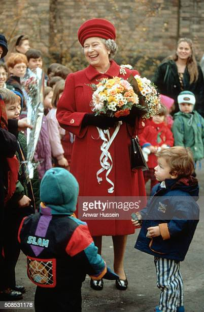 Queen Elizabeth II smiles as she is welcomed by childen during a visit to St Petersburg on October 19 1994 in St Petersburg Russia