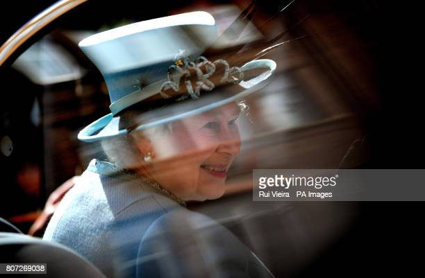 Queen Elizabeth II smiles as she leaves Derby Cathedral after attending the Royal Maundy Service