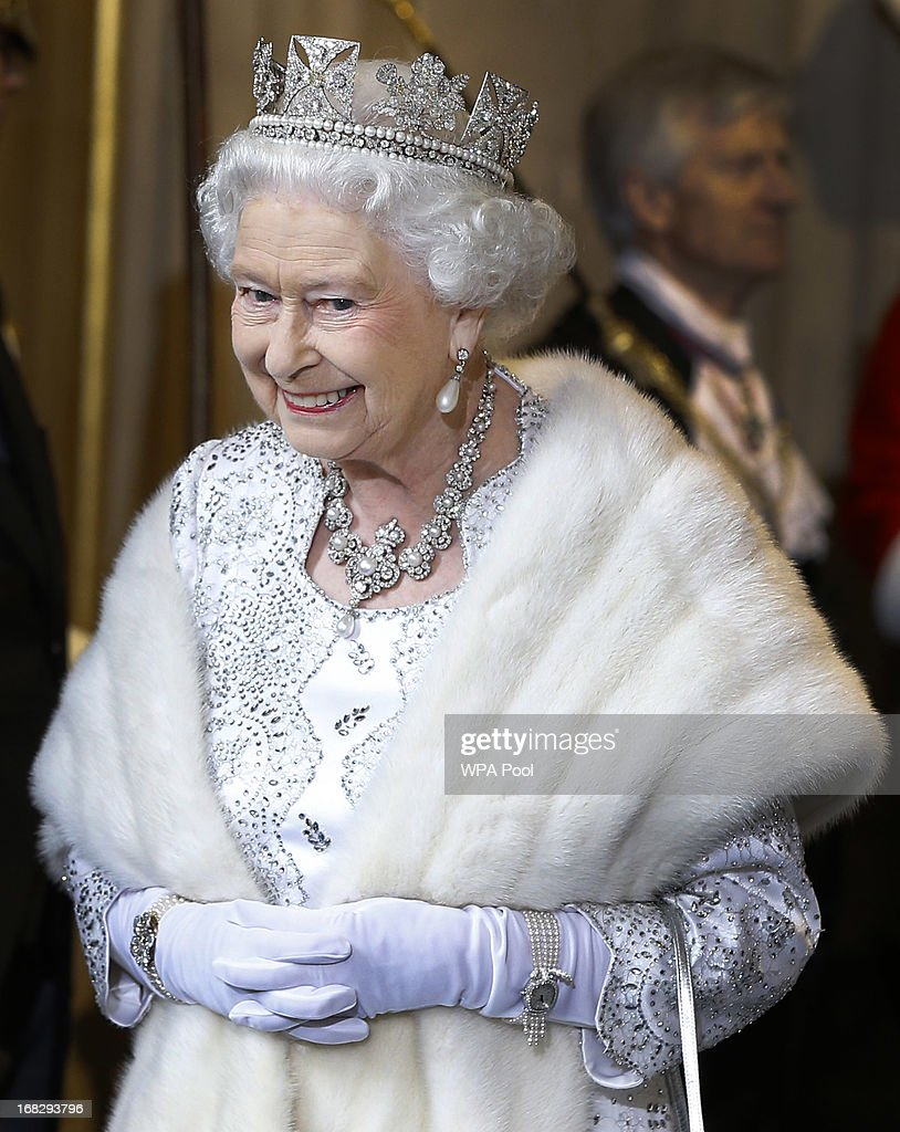 Queen Elizabeth II smiles as she leaves the State Opening of Parliament at the House of Lords on May 8, 2013 in London, England. Queen Elizabeth II unveils the coalition government's legislative programme in a speech delivered to Members of Parliament and Peers in The House of Lords. Proposed legislation is expected to be introduced on toughening immigration regulations, capping social care costs in England and setting a single state pension rate of 144 GBP per week.