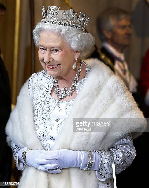 Queen Elizabeth II smiles as she leaves the State Opening of Parliament at the House of Lords on May 8 2013 in London England Queen Elizabeth II...