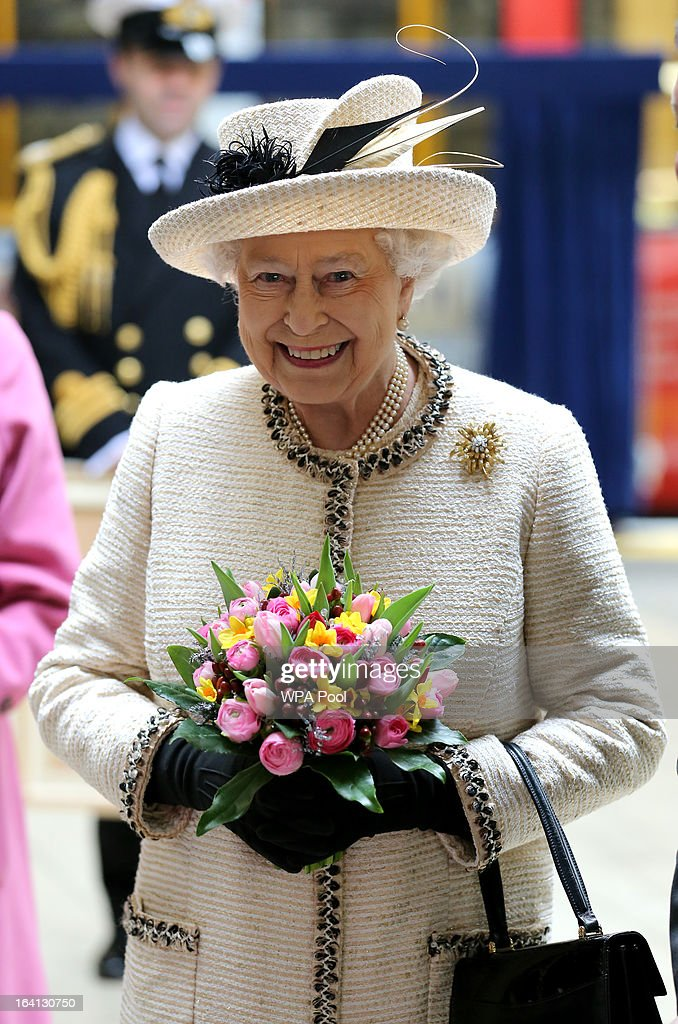 Queen Elizabeth II smiles as she makes an official visit to Baker Street Underground Station, to mark 150th anniversary of the London Underground on March 20, 2013 in London, England.