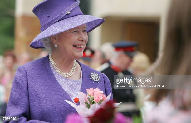 HRH Queen Elizabeth II smiles as she receives a bunch of flowers from wellwishers following a Remembrance Service commemorating 25 years since the...