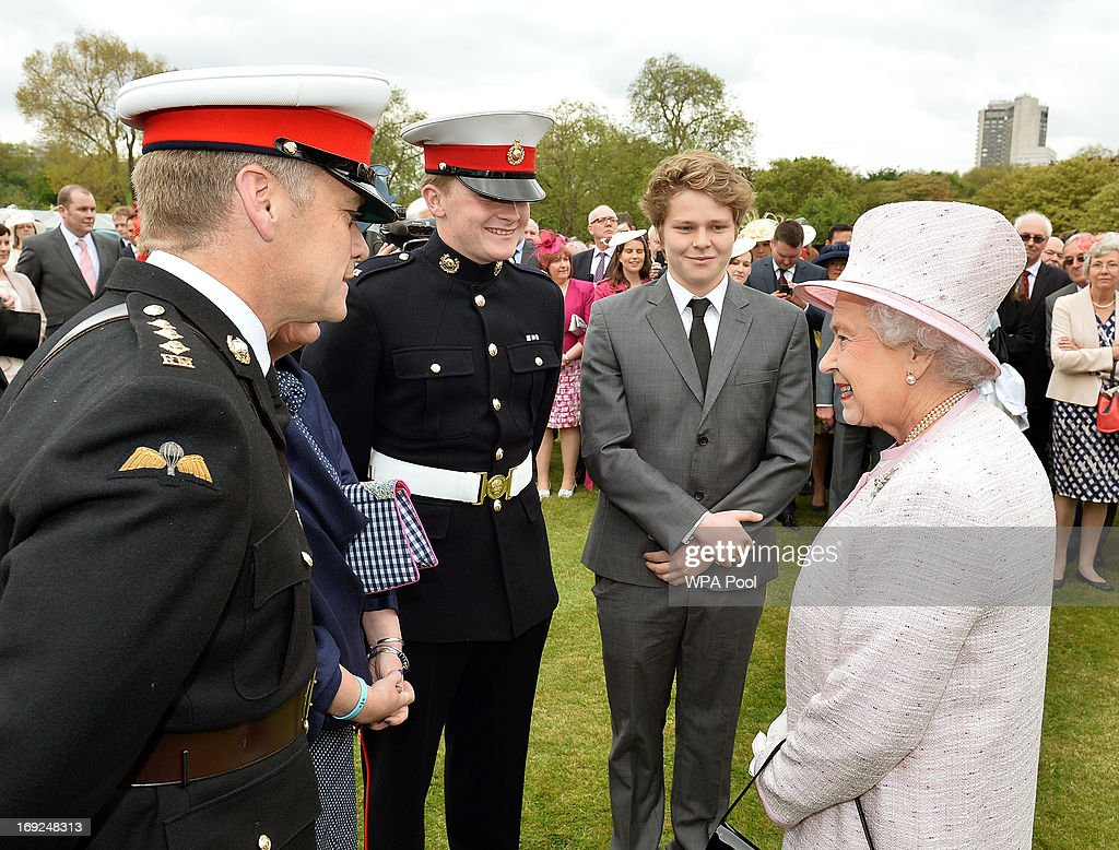 Queen <a gi-track='captionPersonalityLinkClicked' href=/galleries/search?phrase=Elizabeth+II&family=editorial&specificpeople=67226 ng-click='$event.stopPropagation()'>Elizabeth II</a> smiles as she talks Royal Marine guests at a Garden Party she is hosting in the grounds of Buckingham Palace on May 22, 2013.