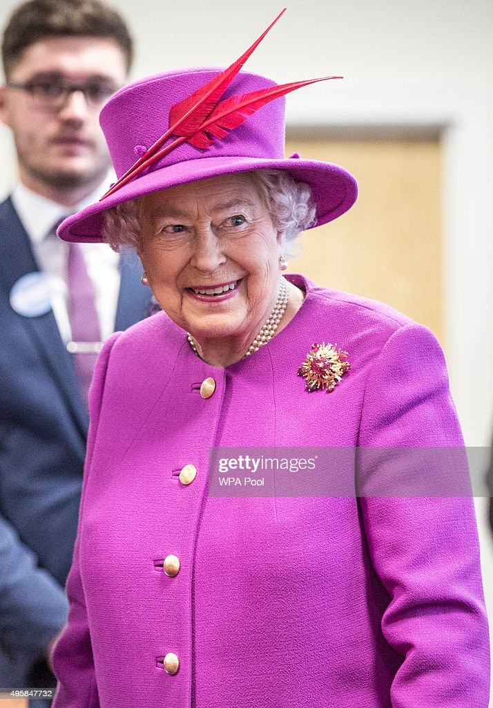 Queen Elizabeth II smiles as she talks to staff at the Ministry of defence medal office at the joint casualty and compassionate centre within Imjin barracks on November 5, 2015 in Innsworth, Gloucestershire, United Kingdom.