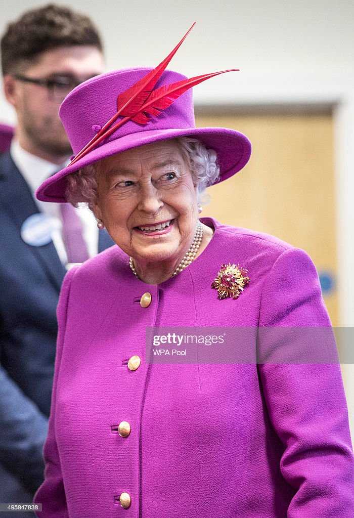Queen Elizabeth II smiles as she talks to staff at the Ministry of defence medal office at the joint casualty and compassionate centre within Imjin...