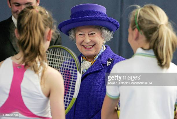 Queen Elizabeth II smiles as she talks to young tennis players during her visit to the new National Tennis Centre Roehampton in London on March 29...