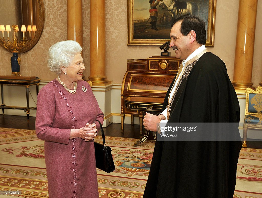 Queen Elizabeth II smiles as she talks with His Excellency the Ambassador of Tunisia Mr Hatem Atallah as he visits the Queen to receive his credentials during a private meeting at Buckingham Palace on December 8, 2010 in London, England.