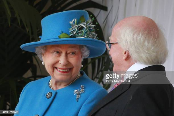 Queen Elizabeth II smiles as she talks with President of Ireland Michael D Higgins during a ceremonial welcome at Windsor Castle on April 8 2014 in...