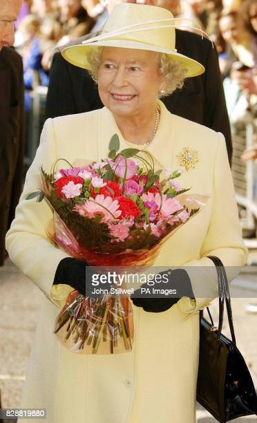 Queen Elizabeth II smiles as she tours the market square in Enfield Town centre London During the visit the Queen and the Duke of Edinburgh will...