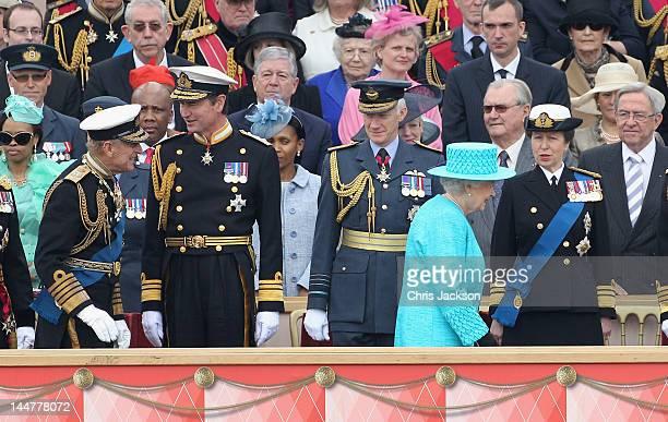 Queen Elizabeth II smiles as she walks past Princess Anne Princess Royal as Prince Philip Duke of Edinburgh greets vice Admiral Sir Timothy Laurence...