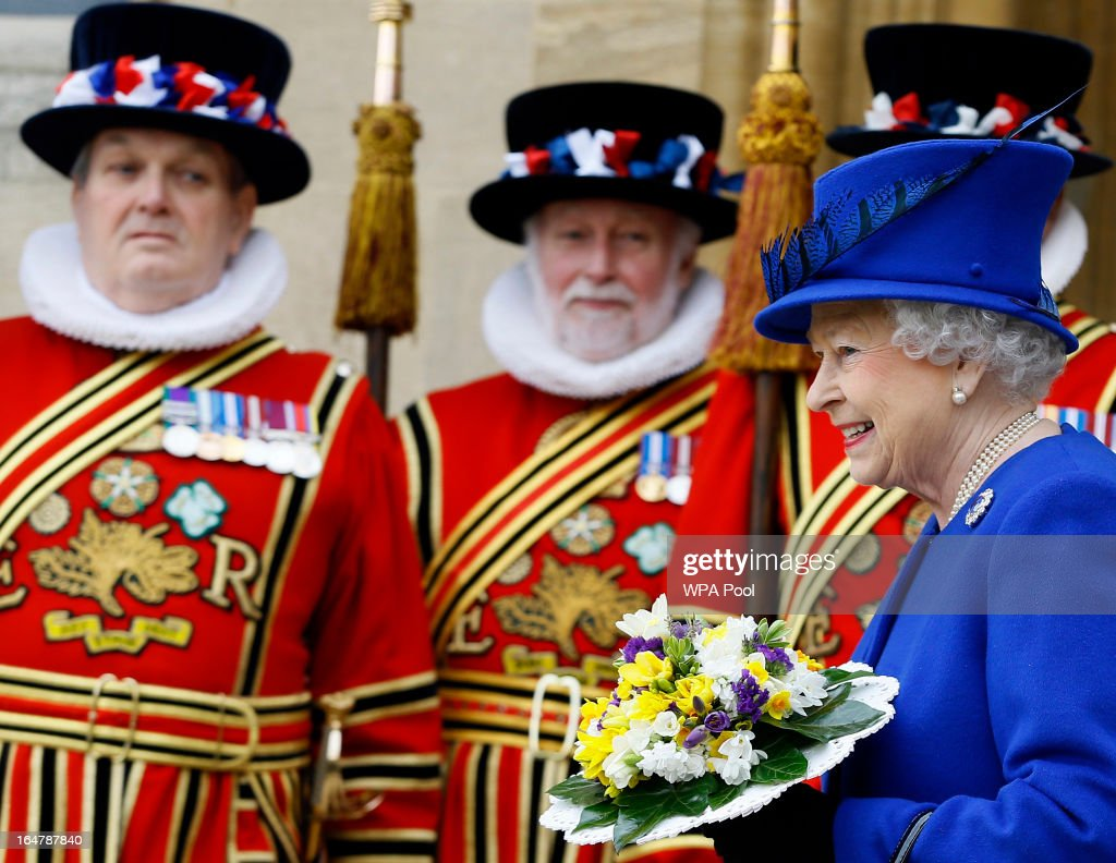 Queen Elizabeth II smiles as she walks past Yeoman of the Guard, after attending the Maundy service, at Christ Church Cathedral on March 28, 2013 in Oxford, England. The Maundy money was today distributed by the Queen to 87 women and 87 men, who each received two purses, one red and one white. A 5 GBP coin and 50 pence coin commemorating the 60th anniversary of The Queen's Coronation in the red purse. The white purse contains the uniquely minted Maundy Money. This takes the form of silver one, two, three and four penny pieces, the sum of which equals the number of years the Monarch's age.