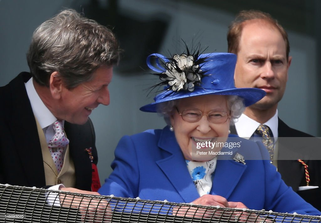 Queen <a gi-track='captionPersonalityLinkClicked' href=/galleries/search?phrase=Elizabeth+II&family=editorial&specificpeople=67226 ng-click='$event.stopPropagation()'>Elizabeth II</a> smiles as she watches The Derby winner come in with her racing manager <a gi-track='captionPersonalityLinkClicked' href=/galleries/search?phrase=John+Warren+-+Racing+Advisor&family=editorial&specificpeople=14677107 ng-click='$event.stopPropagation()'>John Warren</a> (L) and <a gi-track='captionPersonalityLinkClicked' href=/galleries/search?phrase=Prince+Edward+-+Earl+of+Wessex&family=editorial&specificpeople=160185 ng-click='$event.stopPropagation()'>Prince Edward</a>, Earl of Wessex on June 2, 2012 in Epsom, England. For only the second time in its history, the UK celebrates the Diamond Jubilee of a monarch. Her Majesty Queen <a gi-track='captionPersonalityLinkClicked' href=/galleries/search?phrase=Elizabeth+II&family=editorial&specificpeople=67226 ng-click='$event.stopPropagation()'>Elizabeth II</a> celebrates the 60th anniversary of her ascension to the throne. Thousands of wellwishers from around the world have flocked to London to witness the spectacle of the weekend's celebrations. The Queen along with all the members of the royal family will participate in a River Pageant with a flotilla of 1,000 boats accompanying them down the Thames, a star studded free concert at Buckingham Palace, and a carriage procession and a Service of Thanksgiving at St Paul's Cathedral.