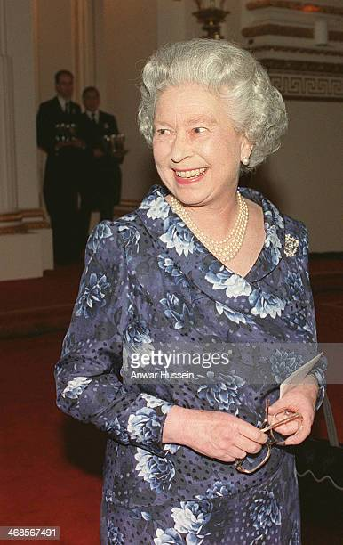 Queen Elizabeth II smiles during a reception for her oldest son the Prince of Wales on the eve of his 50th birthday at Buckingham Palace on November...