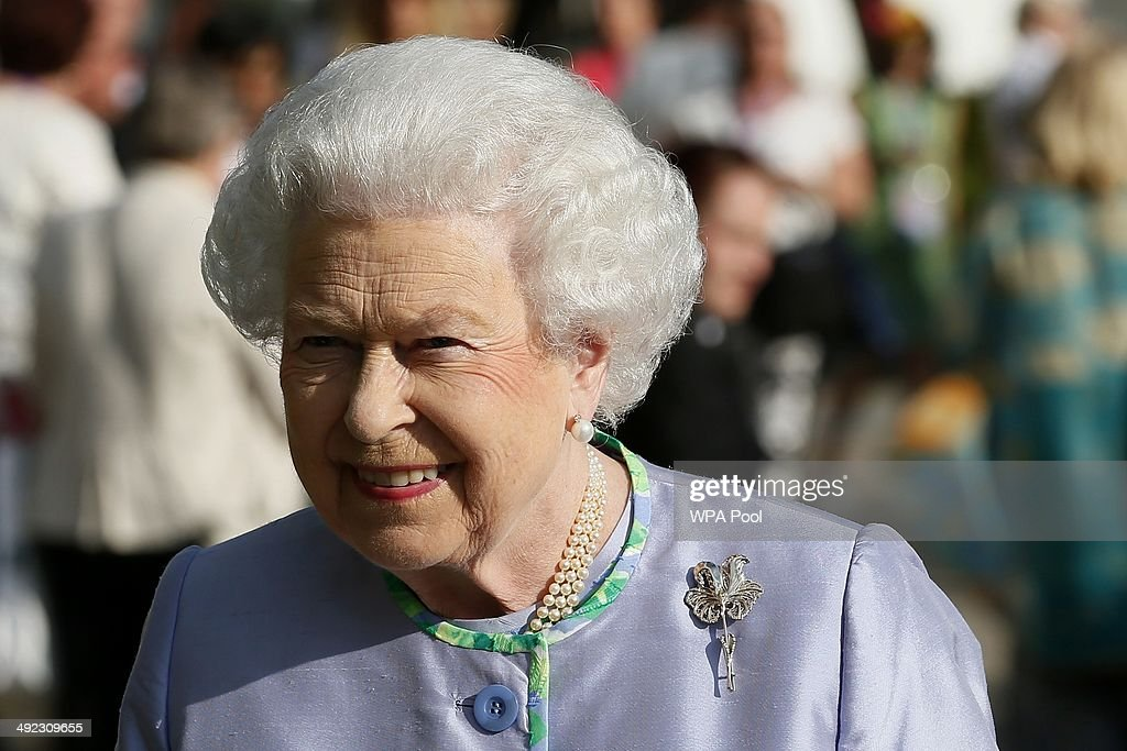 Queen Elizabeth II smiles during a visit to the Chelsea Flower Show on press day on May 19, 2014 in London, England.