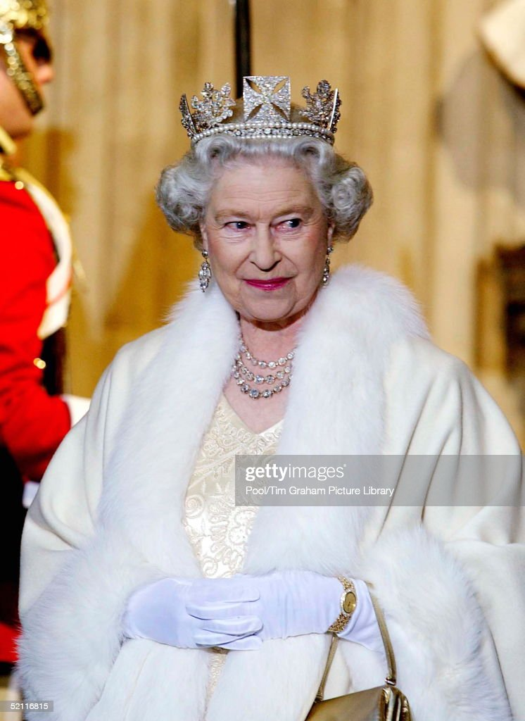 Queen <a gi-track='captionPersonalityLinkClicked' href=/galleries/search?phrase=Elizabeth+II&family=editorial&specificpeople=67226 ng-click='$event.stopPropagation()'>Elizabeth II</a> Smiling As She Arrives At The Palace Of Westminster For The State Opening Of Parliament. The Queen Is Wearing A Diamond Crown Known As The State Diadem Made For The Coronation Of George Lv. She Is Wearing An Embroidered Cream Satin Dress Covered With A Fur-trimmed Robe.