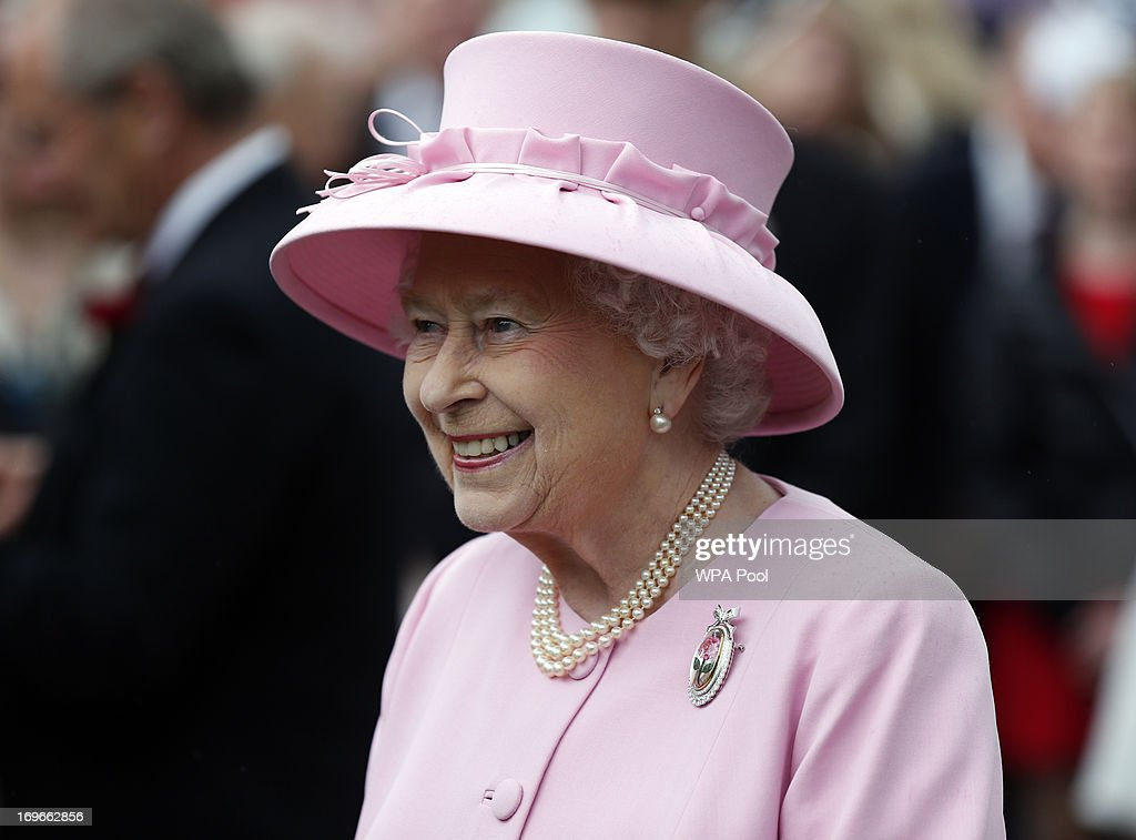 Queen Elizabeth II speaks to guests during a garden party held at Buckingham Palace, on May 30, 2013 in London, England.