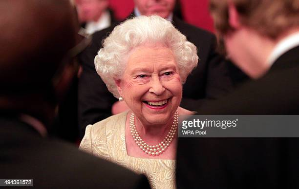 Queen Elizabeth II speaks to guests during a reception for The Queen Elizabeth Prize for Engineering in the Throne Room at Buckingham Palace on...