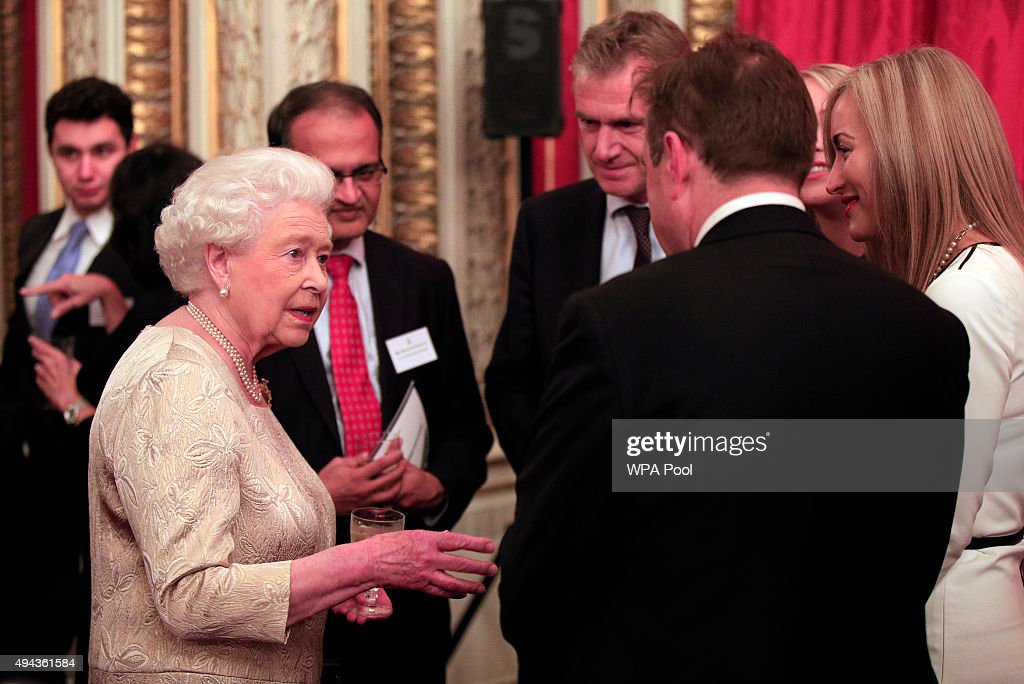 Queen Elizabeth II (left) speaks to guests during a reception for The Queen Elizabeth Prize for Engineering in the Throne Room at Buckingham Palace on October 26, 2015 in London, England. The Queen has presented a £1 million engineering prize to Dr Robert Langer at a reception at Buckingham Palace.