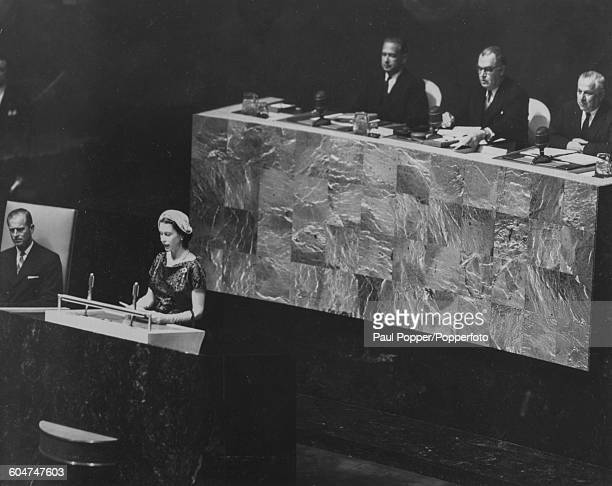 Queen Elizabeth II speaks to members in the Assembly Hall at the United Nations General Assembly watched by Prince Philip Duke of Edinburgh in New...
