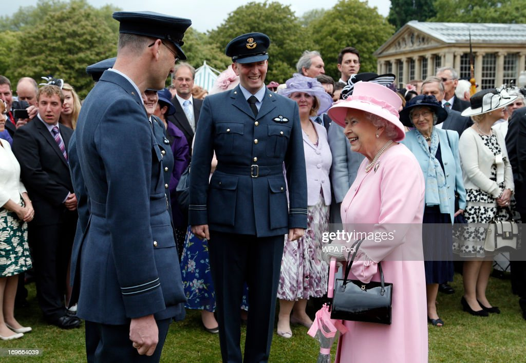 Queen <a gi-track='captionPersonalityLinkClicked' href=/galleries/search?phrase=Elizabeth+II&family=editorial&specificpeople=67226 ng-click='$event.stopPropagation()'>Elizabeth II</a> speaks to members of the RAF Abingdon Volunteer Gliding Squadron (names not known)during a garden party held at Buckingham Palace, on May 30, 2013 in London, England.