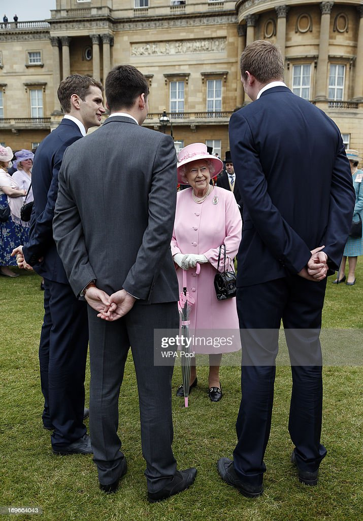 Queen <a gi-track='captionPersonalityLinkClicked' href=/galleries/search?phrase=Elizabeth+II&family=editorial&specificpeople=67226 ng-click='$event.stopPropagation()'>Elizabeth II</a> speaks to members of the Team GB Olympic Water Polo team (names not known) during a garden party held at Buckingham Palace, on May 30, 2013 in London, England.
