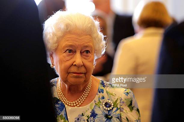 Queen Elizabeth II speaks to Prime Minister David Cameron during a reception in Buckingham Palace to mark the Queen's 90th birthday on May 10 2016 in...