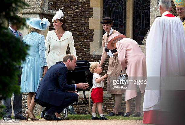 Queen Elizabeth II speaks to Prince George of Cambridge as Catherine Duchess of Cambridge Prince William Duke of Cambridge and Princess Charlotte of...