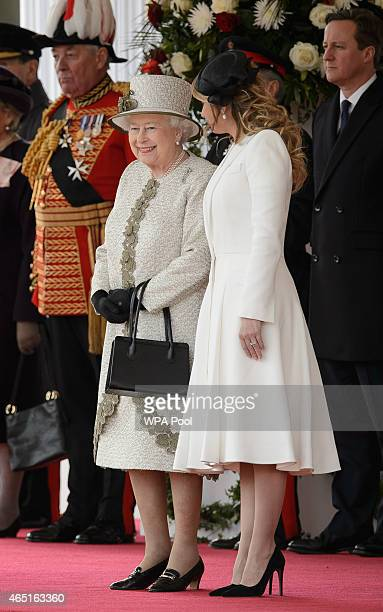 Queen Elizabeth II speaks with Angelica Rivera wife of Mexican President Enrique Pena Nieto during a Ceremonial Welcome at Horse Guards Parade on...