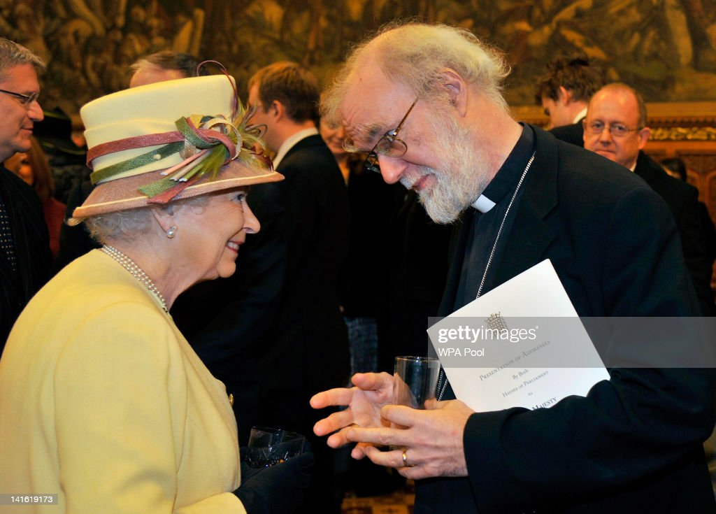 Queen Elizabeth II speaks with Archbishop of Canterbury <a gi-track='captionPersonalityLinkClicked' href=/galleries/search?phrase=Rowan+Williams&family=editorial&specificpeople=239468 ng-click='$event.stopPropagation()'>Rowan Williams</a> during a reception at the Houses of Parliament on March 20, 2012 in London, England. Following the address to party leaders, MP's, peers and dignitaries from both the House of Commons and the House of Lords, a specially commissioned Diamond Jubilee stained glass window, a gift from the members of both Houses, was unveiled to mark the Queen's 60 year reign.