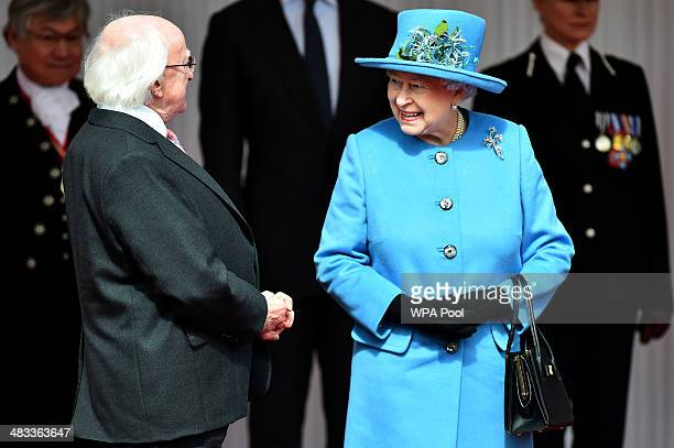 Queen Elizabeth II speaks with Irish President Michael D Higgins during a ceremonial welcome at Windsor Castle on April 8 2014 in England This is the...