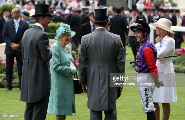 Queen Elizabeth II speaks with jockey Jim Crowley prior to his ride on Call To Mind in the King Edward VII Stakes during day four of Royal Ascot at...