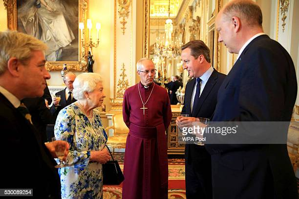 Queen Elizabeth II speaks with Prime Minister David Cameron as Chris Grayling leader of the House of Commons and Archbishop of Canterbury Justin...
