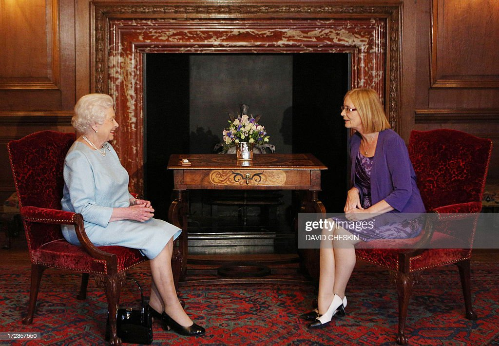 Queen Elizabeth II speaks with Scottish Parliament Presiding Officer Tricia Marwick (R) during an audience at the Palace of Holyrood House in Edinburgh on July 2, 2013. AFP PHOTO/POOL/ David Cheskin