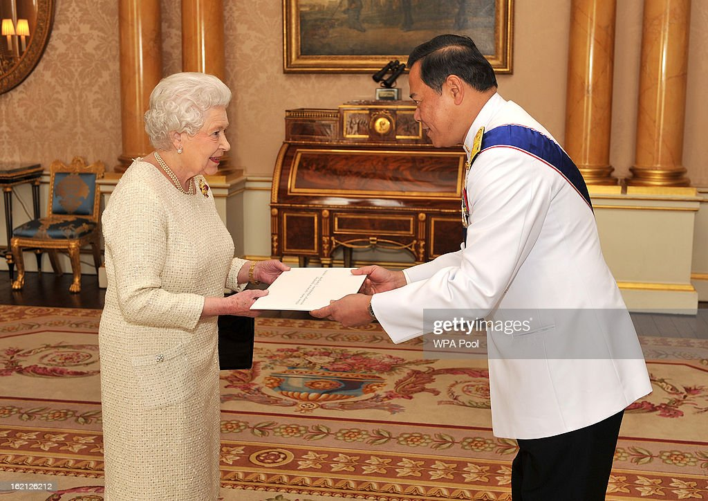 Queen Elizabeth II speaks with the Ambassador of the Thailand Mr Pasan Teparak, during a private audience presenting his Credentials at Buckingham Palace on February 19, 2013 in London, England.