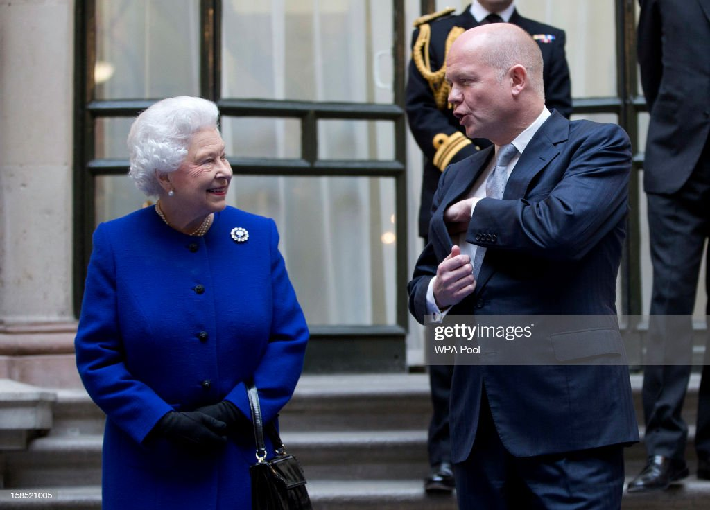 Queen <a gi-track='captionPersonalityLinkClicked' href=/galleries/search?phrase=Elizabeth+II&family=editorial&specificpeople=67226 ng-click='$event.stopPropagation()'>Elizabeth II</a> speaks with the British Foreign Secretary <a gi-track='captionPersonalityLinkClicked' href=/galleries/search?phrase=William+Hague&family=editorial&specificpeople=206295 ng-click='$event.stopPropagation()'>William Hague</a> as she arrives for a tour of The Foreign and Commonwealth Office during an official visit which is part of her Jubilee celebrations on December 18, 2012 in London, England.