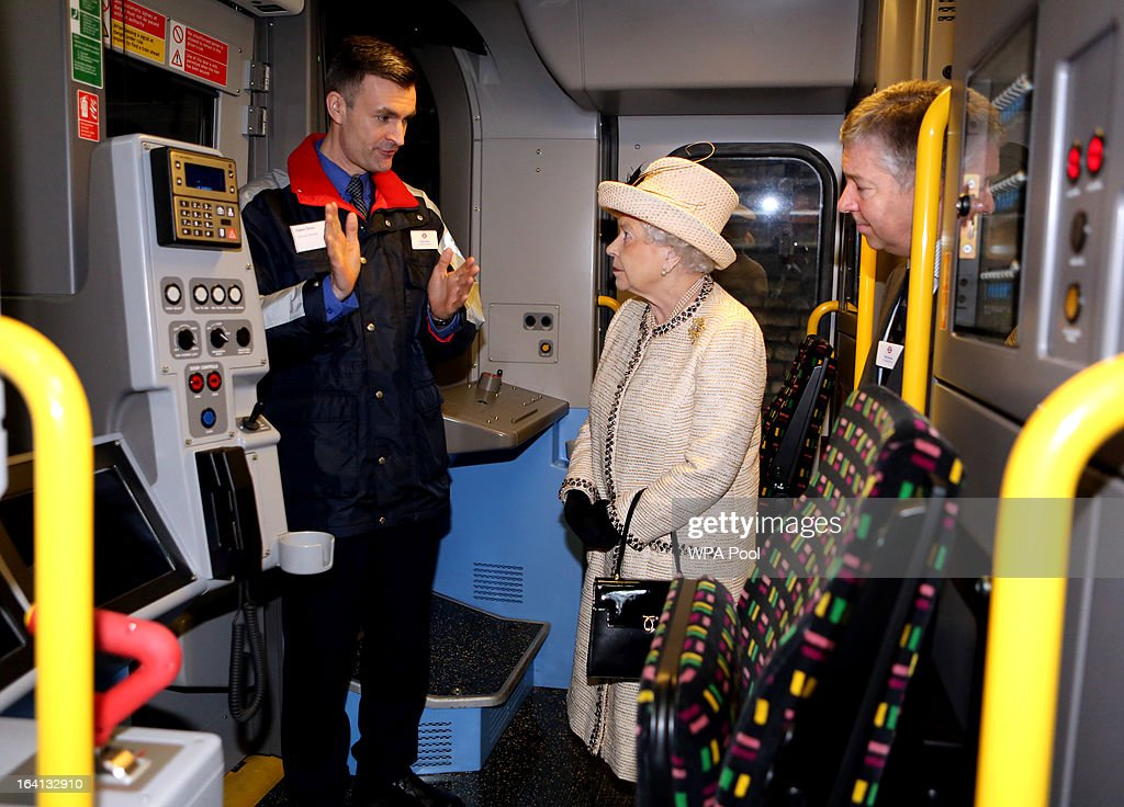 Queen Elizabeth II stands in a drivers' cabin as she makes an official visit to Baker Street Underground Station, to mark 150th anniversary of the London Underground on March 20, 2013 in London, England.