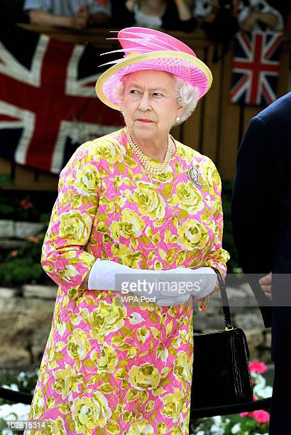 Queen Elizabeth II stands in the garden of Government House where she unveiled a statue of herself on July 3 2010 in Winnipeg Canada The Queen and...