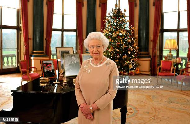 Queen Elizabeth II stands in the Music Room of Buckingham Palace after recording her Christmas day message to the Commonwealth on December 2008 in...