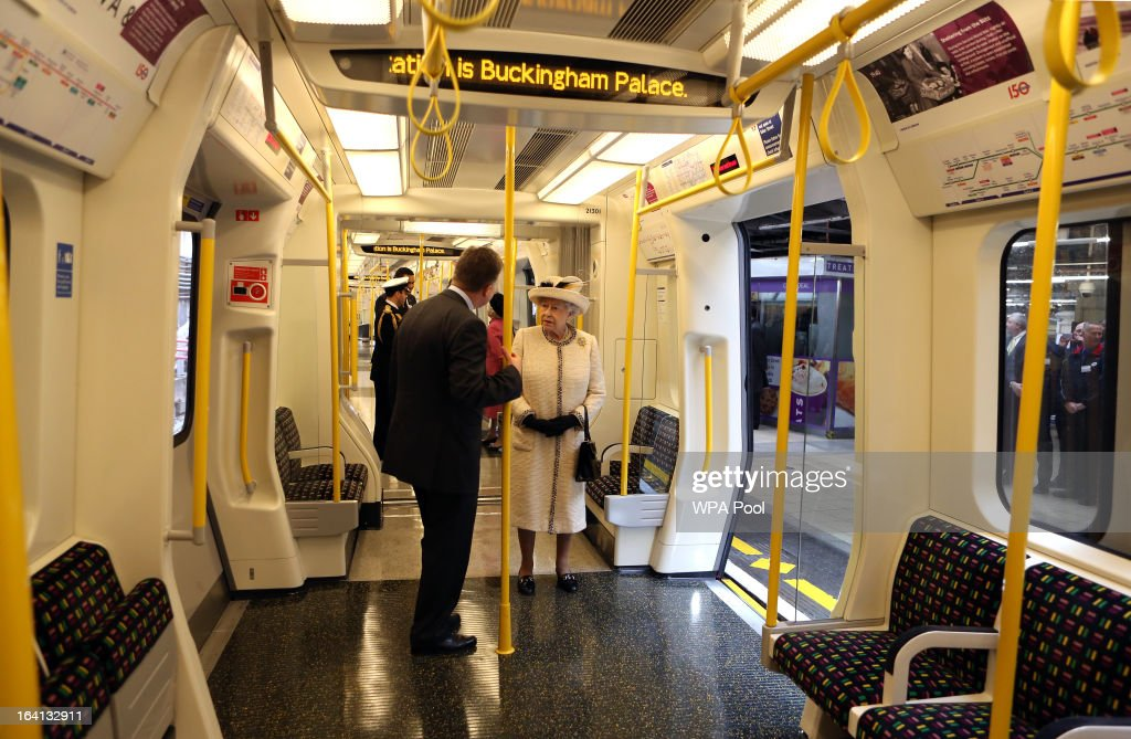 Queen Elizabeth II stands onboard a train as she makes an official visit to Baker Street Underground Station, to mark 150th anniversary of the London Underground on March 20, 2013 in London, England.