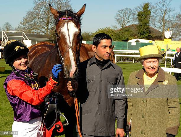 Queen Elizabeth II stands with her horse Tactician after Hayley Turner rode him to victory in The racingukcom Maiden Stakes at Newbury racecourse on...