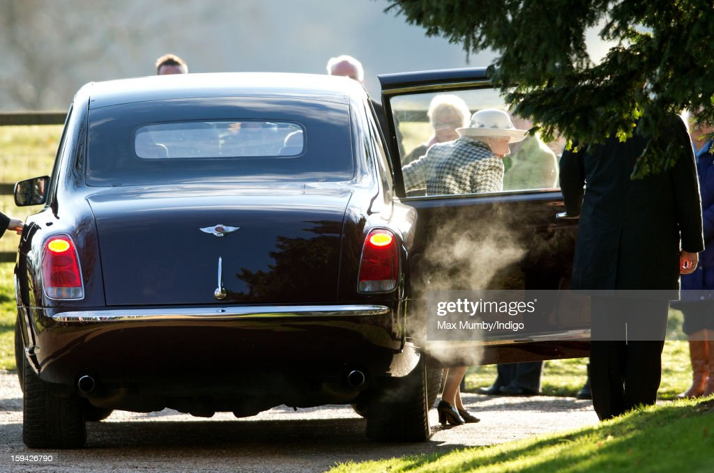 Queen Elizabeth II steps out of her Bentley car as she arrives at St. Mary Magdalene Church, Sandringham to attend Sunday service along with Prince Philip, Duke of Edinburgh and Lady Helen Taylor on January 13, 2012 near King's Lynn, England.
