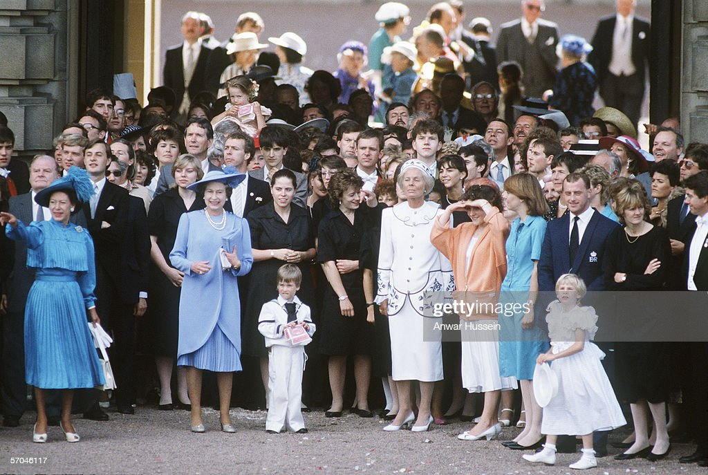 Queen Elizabeth II surrounded by family and friends bid farewell to the Duke and Duchess of York as they set off on honeymoon after their wedding on July 23rd 1986.
