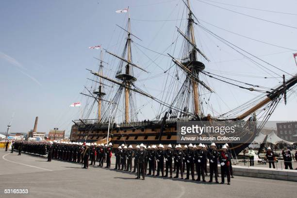 HRH Queen Elizabeth II takes a salute from Royal Navy troops from HMS Victory the two hundred year old ship that was famously captained by Rear...