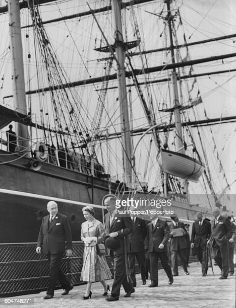 Queen Elizabeth II takes an opening day tour of the Cutty Sark clipper ship which has a new permanent berth at Greenwich London on June 24th 1957