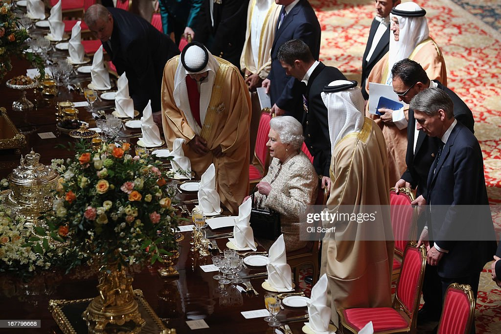 Queen <a gi-track='captionPersonalityLinkClicked' href=/galleries/search?phrase=Elizabeth+II&family=editorial&specificpeople=67226 ng-click='$event.stopPropagation()'>Elizabeth II</a> (C) takes her seat for a State Luncheon for The President of the United Arab Emirates, His Highness Sheikh Khalifa bin Zayed Al Nahyan (2nd L), in the Waterloo Chamber of Windsor Castle on April 30, 2013 in Windsor, England. The President of the United Arab Emirates is paying a two-day State Visit to the United Kingdom, staying in Windsor Castle as the guest of Her Majesty The Queen from April 30, 2013 to May 1, 2013. Sheikh Khalifa will meet the British Prime Minister David Cameron tomorrow at his Downing Street residence.
