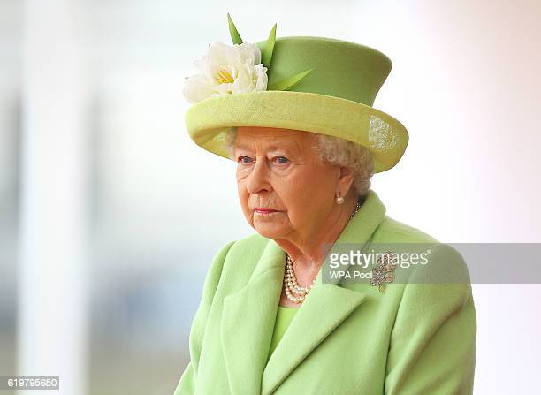 Queen Elizabeth II takes part in a ceremonial welcome for Colombia's President Juan Manuel Santos and his wife Maria Clemencia de Santos at Horse...